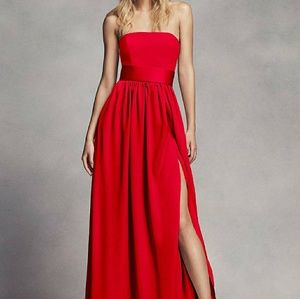 Long strapless bridesmaid dress with a belt.